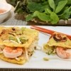 Delicious Savory Crepes Served with Fresh Herbs and Fish Sauce Dipping Sauce | recipe from runawayrice.com
