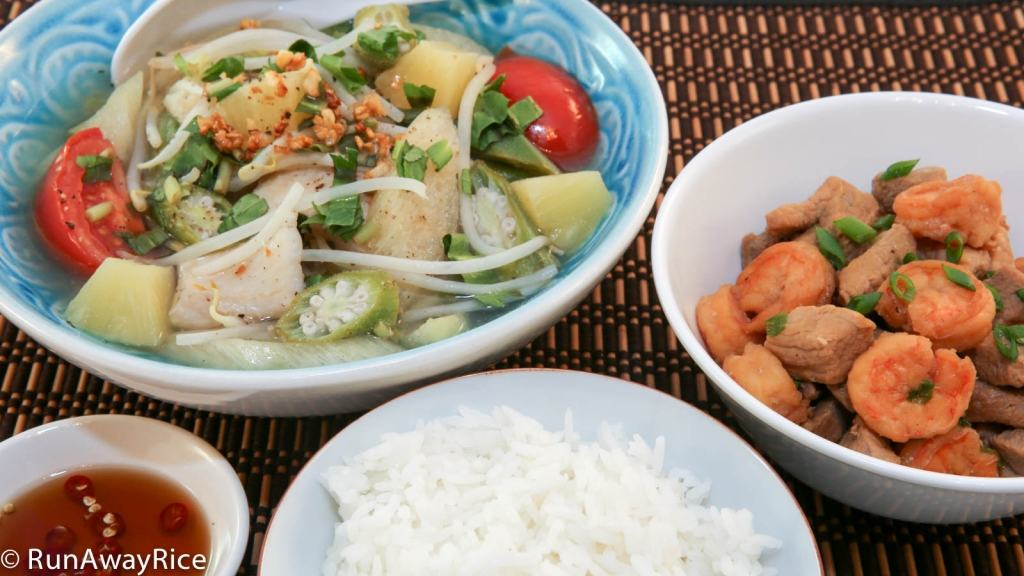 A traditional Vietnamese meal of Sour Soup with Braised Pork and Shrimp
