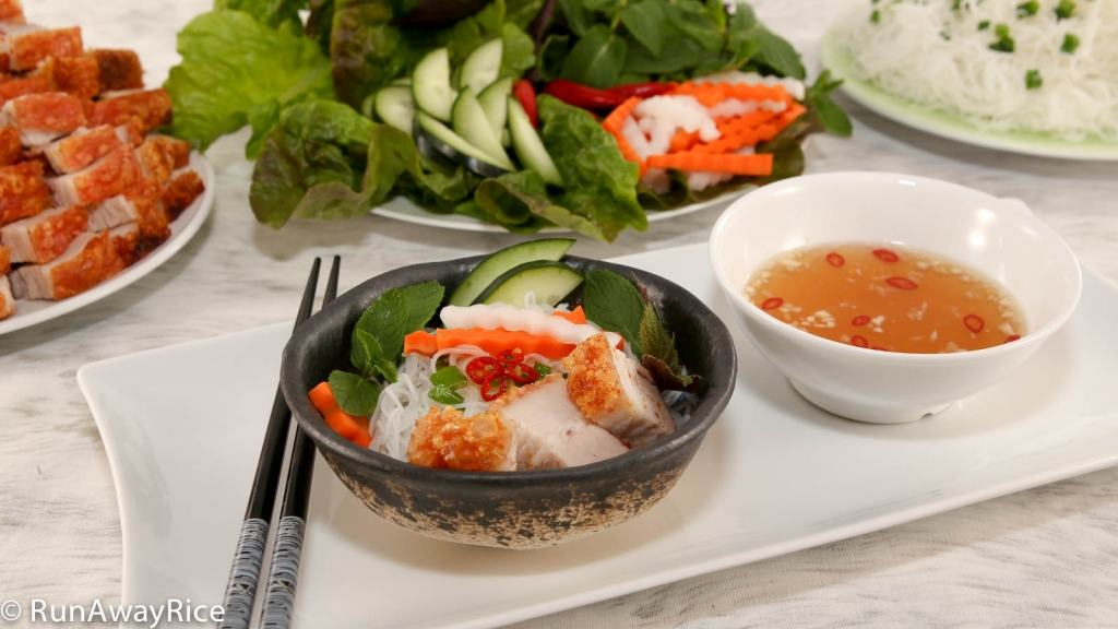 Serve the Crispy Roast Pork with Fine Rice Noodles, Fresh Herbs, Carrot and Radish Pickles and Fish Sauce Dipping Sauce for a truly delicious Viet meal!