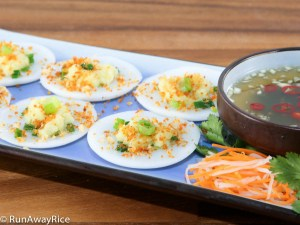 Delicate steamed rice cakes topped with mashed mung beans, toasted shrimp and scallion oil. Served with a side of fish sauce dipping sauce and carrot and radish pickles.