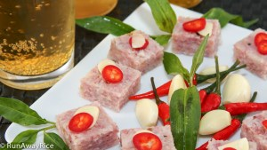 Cured Fermented Pork / Nem Chua served with Vietnamese coriander, red chilies and garlic slices and enjoyed with cold beer | recipe from runawayrice.com