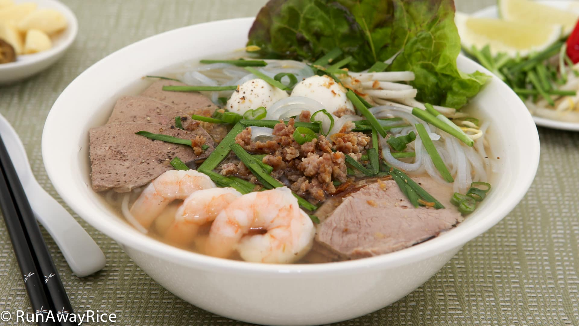 Pork and Shrimp Clear Noodle Soup (Hu Tieu) - amazing soup with a plethora of meats and fresh vegetables | recipe from runawayrice.com