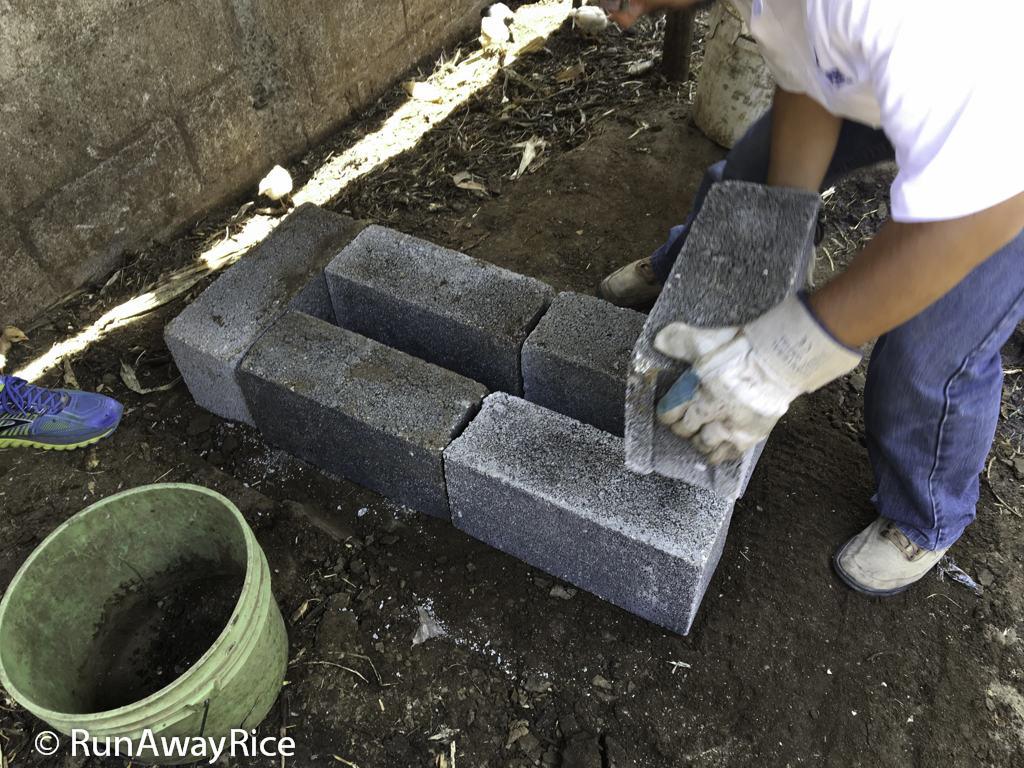Installing Onil Stove-Laying down cinder blocks | runawayrice.com